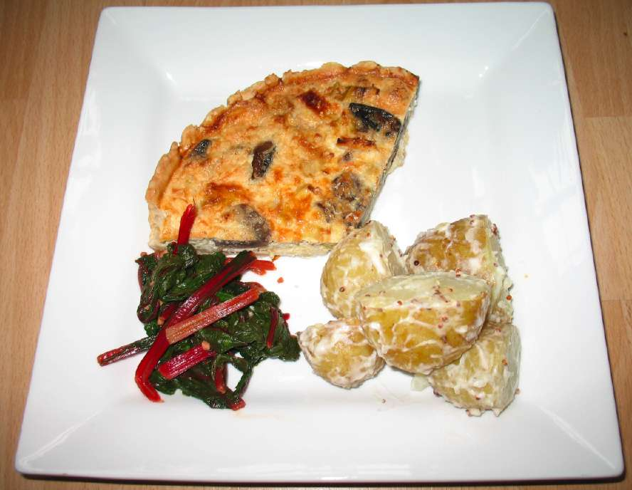 Leek and Mushroom Quiche, served with potatoes and red chard
