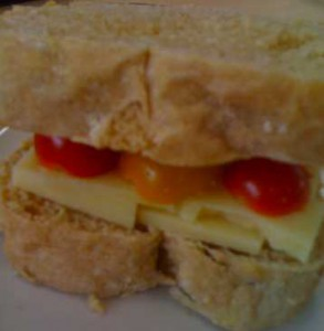 Sandwich made with cheese, tomatoes and anadama bread
