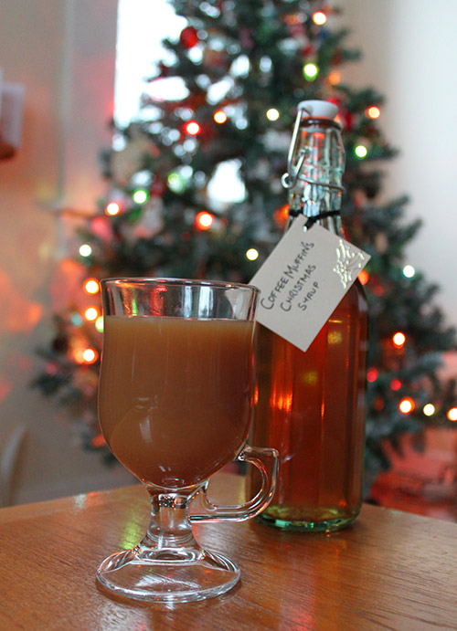 Christmas Flavoured Syrup for Coffee (with Christmas tree in the background)